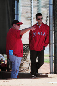 February 21, 2012; Tempe, AZ, USA; Los Angeles Angels manager Mike Scioscia (left) talks to general manager Jerry Dipoto (right) during spring training at Tempe Diablo Stadium. Mandatory Credit: Kyle Terada-USA TODAY Sports