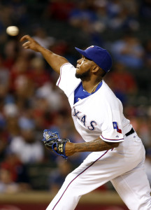 May 12, 2015; Arlington, TX, USA; Texas Rangers relief pitcher Neftali Feliz (30) throws a pitch in the ninth inning against the Kansas City Royals at Globe Life Park in Arlington. The Royals won 7-6 in 10 innings. Mandatory Credit: Tim Heitman-USA TODAY Sports