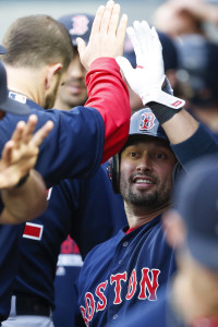 May 15, 2015; Seattle, WA, USA; Boston Red Sox right fielder Shane Victorino (18) gets a high-five in the dugout after scoring a run against the Seattle Mariners during the first inning at Safeco Field. Mandatory Credit: Joe Nicholson-USA TODAY Sports