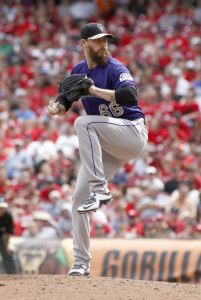 May 25, 2015; Cincinnati, OH, USA; Colorado Rockies relief pitcher John Axford (66) throws against the Cincinnati Reds in the ninth inning at Great American Ball Park. The Rockies won 5-4. Mandatory Credit: David Kohl-USA TODAY Sports