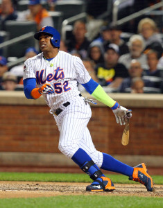 Oct 13, 2015; New York City, NY, USA; New York Mets left fielder Yoenis Cespedes (52) hits an infield single against the Los Angeles Dodgers during the seventh inning in game four of the NLDS at Citi Field. Mandatory Credit: Brad Penner-USA TODAY Sports