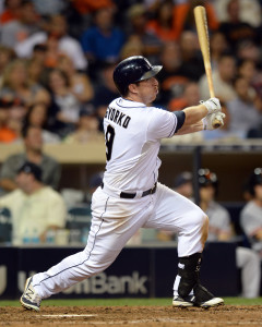 Sep 23, 2015; San Diego, CA, USA; San Diego Padres shortstop Jedd Gyorko (9) hits a game winning walk off RBI single against the San Francisco Giants during the ninth inning to win the game 5-4 at Petco Park. Mandatory Credit: Jake Roth-USA TODAY Sports
