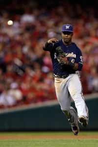 Sep 26, 2015; St. Louis, MO, USA; Milwaukee Brewers shortstop Jean Segura (9) makes a play during the eighth inning of a baseball game against the St. Louis Cardinals at Busch Stadium. Mandatory Credit: Scott Kane-USA TODAY Sports