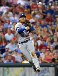Aug 18, 2016; Philadelphia, PA, USA; Los Angeles Dodgers third baseman Justin Turner (10) throws to first for an out against the Philadelphia Phillies at Citizens Bank Park. Mandatory Credit: Bill Streicher-USA TODAY Sports