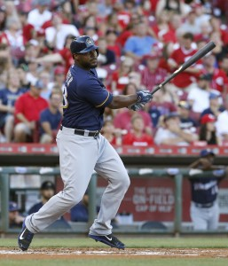 Jul 16, 2016; Cincinnati, OH, USA; Milwaukee Brewers first baseman Chris Carter hits an RBI double against the Cincinnati Reds during the first inning at Great American Ball Park. Mandatory Credit: David Kohl-USA TODAY Sports
