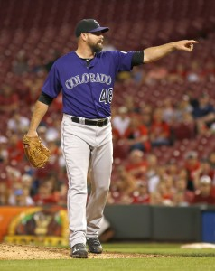 Apr 18, 2016; Cincinnati, OH, USA; Colorado Rockies relief pitcher Boone Logan points to home during the ninth inning against the Cincinnati Reds at Great American Ball Park. The Rockies won 5-1. Mandatory Credit: David Kohl-USA TODAY Sports