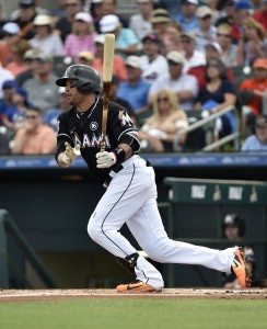 Feb 28, 2017; Jupiter, FL, USA; Miami Marlins third baseman Martin Prado (14) at bat against the New York Mets during a spring training game at Roger Dean Stadium. Mandatory Credit: Steve Mitchell-USA TODAY Sports